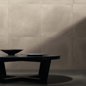 A coffee table and walls with Leonardo Ceramica Factory Tiles