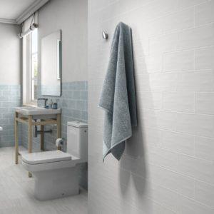 A bathroom with White Aqua Flamant Tile Flooring