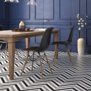 A table and chair with Casa Blanca Tile flooring