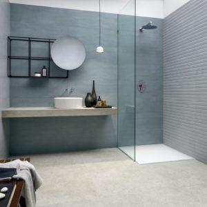 A modern bathroom with Deep Powder Esprit Stone Ocean Cerdisa Espirit Tile