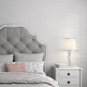 A bedroom with White Flow Tile on the walls