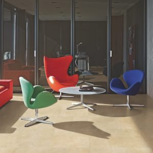 Colorful wing-backed chairs with Luxury Collection Tile Flooring