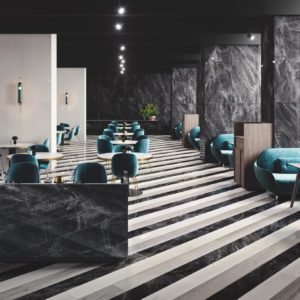 A seating area with Colorado Black Mirror Gemme Tile Flooring