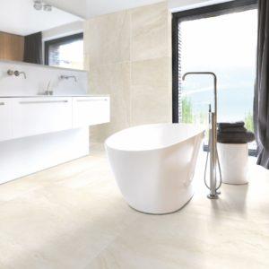 A modern bathroom with Pierre Belle tile flooring