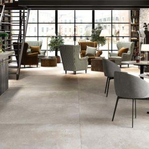 An elegant living room with Dom Ceramiche Mas de Provence Cloud tile