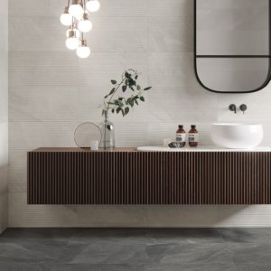 An ultra contemporary bathroom with floating vanity featuring shale collection tile from Italgraniti